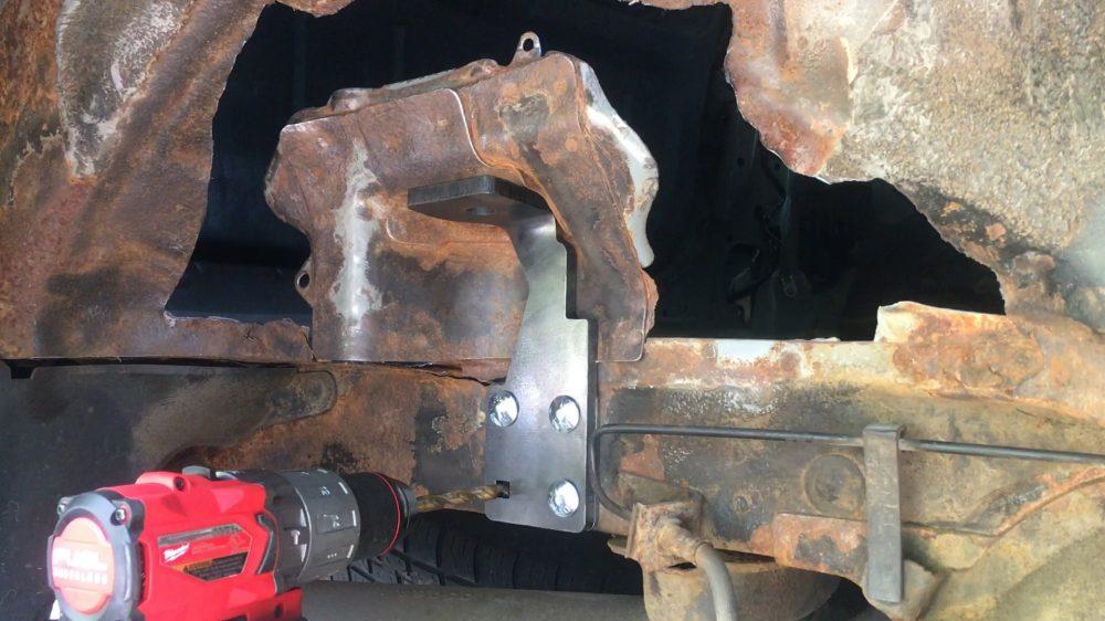 Bolting the bracket to the frame - BSS Rear Passenger Shock Mount Reinforcement Bracket Kit